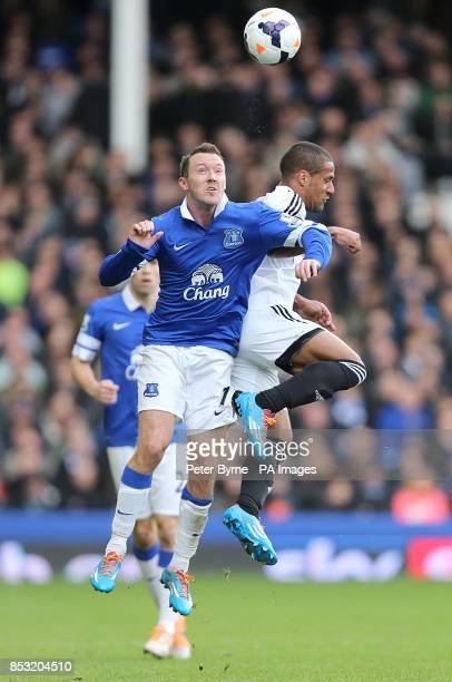 Everton's Aiden McGeady and Swansea City's Wayne Routledge battle for the ball in the air