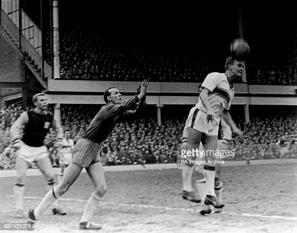 Everton's Alex Young tries to get his head to a cross watched by West Ham United's Bobby Moore and goalkeeper Brian Rhodes