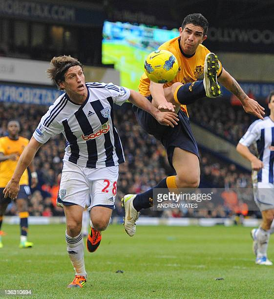 Everton's Argentine forward Denis Stracqualursi vies with West Bromwich Albion's English defender Billy Jones during the English Premier League...