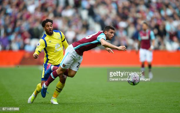 Everton's Ashley Williams and West Ham United's Jonathan Calleri battle for the ball during the Premier League match at London Stadium