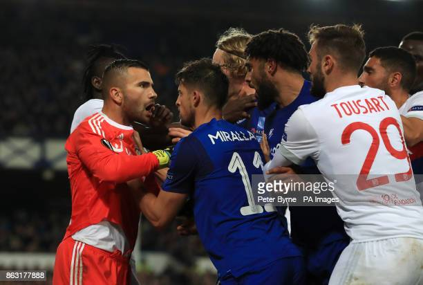 Everton's Ashley Williams clashes with Olympique Lyonnais goalkeeper Anthony Lopes during the UEFA Europa League Group E match at Goodison Park...