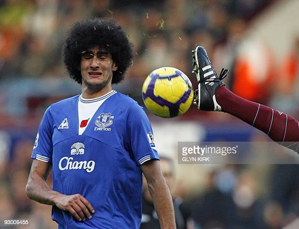 Everton's Belgian midfielder Marouane Fellaini avoids a high West ham boot during the English Premier League football match between West Ham United...