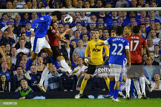 Everton's Belgian midfielder Marouane Fellaini heads the opening goal during the English Premier League football match between Everton and Manchester...