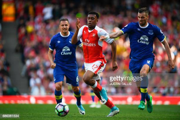 Everton's Belgian striker Kevin Mirallas chases Arsenal's Nigerian striker Alex Iwobi during the English Premier League football match between...
