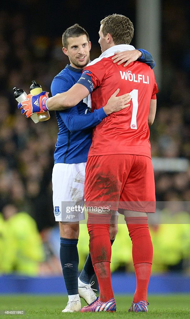 Everton's Belgian striker <a gi-track='captionPersonalityLinkClicked' href=/galleries/search?phrase=Kevin+Mirallas&family=editorial&specificpeople=745704 ng-click='$event.stopPropagation()'>Kevin Mirallas</a> (L) embraces Young Boys' Swiss goalkeeper Marco Wolfli (R) after the UEFA Europa League round of 32 second leg football match between Everton FC and BSC Young Boys at the Goodison Park in Liverpool on February 26, 2015.