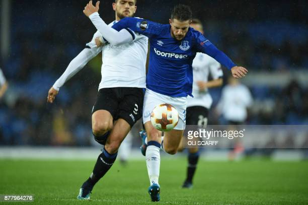 Everton's Belgian striker Kevin Mirallas vies with Atalanta's Brazilian defender Rafael Toloi during the UEFA Europa League Group E football match...
