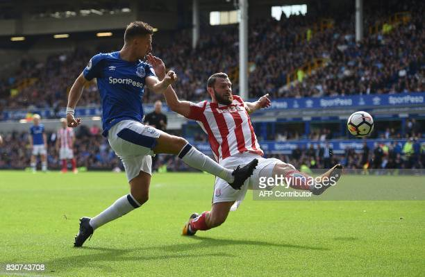 Everton's Belgian striker Kevin Mirallas vies with Stoke City's Dutch defender Erik Pieters peterduring the English Premier League football match...