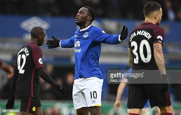 Everton's Belgian striker Romelu Lukaku celebrates after scoring the opening goal of the English Premier League football match between Everton and...