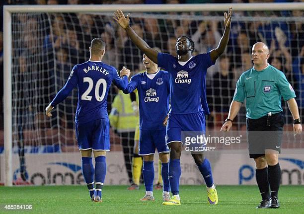 Everton's Belgian striker Romelu Lukaku celebrates his team's fifth goal during the English League Cup football match between Barnsley and Everton at...