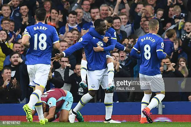 Everton's Belgian striker Romelu Lukaku celebrates with teammates after scoring the opening goal of the English Premier League football match between...
