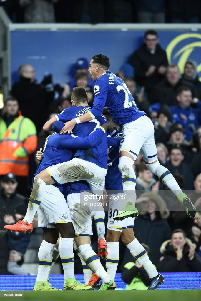 Everton's Belgian striker Romelu Lukaku celebrates with teammates after scoring their fifth goal, his fourth during the English Premier League football match between Everton and Bournemouth at Goodison Park in Liverpool, north west England on February 4, 2017. / AFP / Oli SCARFF / RESTRICTED TO EDITORIAL USE. No use with unauthorized audio, video, data, fixture lists, club/league logos or 'live' services. Online in-match use limited to 75 images, no video emulation. No use in betting, games or single club/league/player publications. /