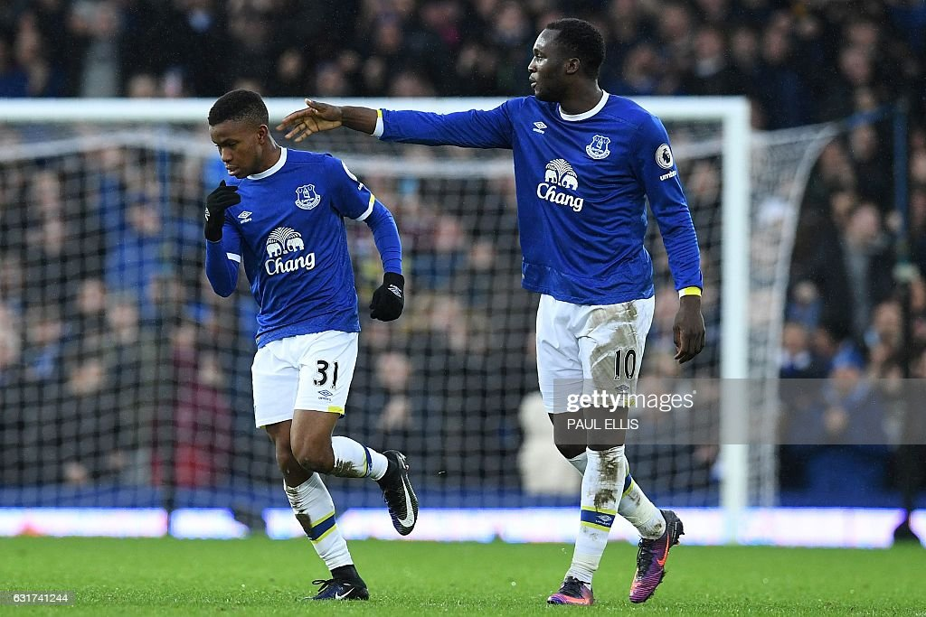 Everton's Belgian striker Romelu Lukaku (R) congratulates Everton's English striker Ademola Lookman on scoring his debut goal during the English Premier League football match between Everton and Manchester City at Goodison Park in Liverpool, north-west England on January 15, 2017. Everton won the match 4-0. / AFP / Paul ELLIS / RESTRICTED TO EDITORIAL USE. No use with unauthorized audio, video, data, fixture lists, club/league logos or 'live' services. Online in-match use limited to 75 images, no video emulation. No use in betting, games or single club/league/player publications. /