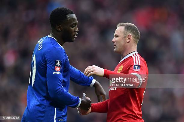 Everton's Belgian striker Romelu Lukaku embraces Manchester United's English striker Wayne Rooney after the final whistle of the English FA Cup...