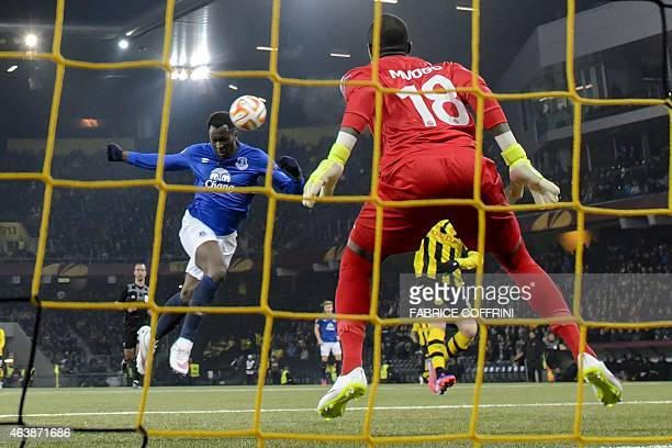 Everton's Belgian striker Romelu Lukaku heads the ball in front of Young Boys' goalkeeper from Namibia Yvon Mvogo on February 19 2015 during the UEFA...