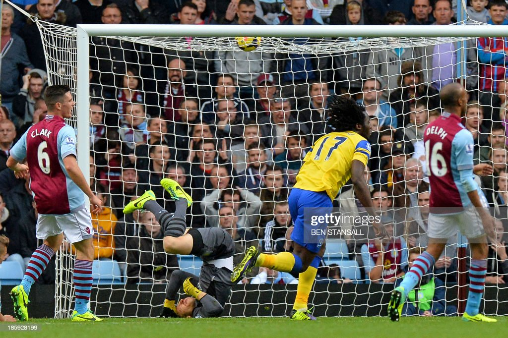 Everton's Belgian striker Romelu Lukaku (2nd R) scores the opening goal past Aston Villa's US goalkeeper Brad Guzan (2nd L) during the English Premier League football match between Aston Villa and Everton at Villa Park in Birmingham on October 26, 2013. USE. No use with unauthorized audio, video, data, fixture lists, club/league logos or live services. Online in-match use limited to 45 images, no video emulation. No use in betting, games or single club/league/player publications.