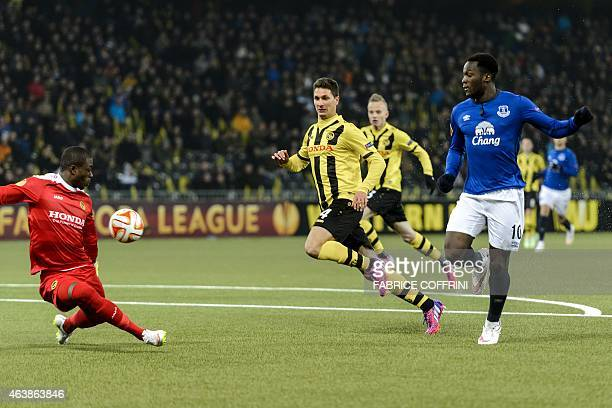 Everton's Belgian striker Romelu Lukaku scores the team's fourth goal against Young Boys' goalkeeper from Namibia Yvon Mvogo on February 19 2015 his...