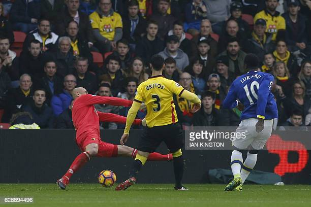 Everton's Belgian striker Romelu Lukaku shoots and scores past Watford's Brazilian goalkeeper Heurelho Gomes during the English Premier League...