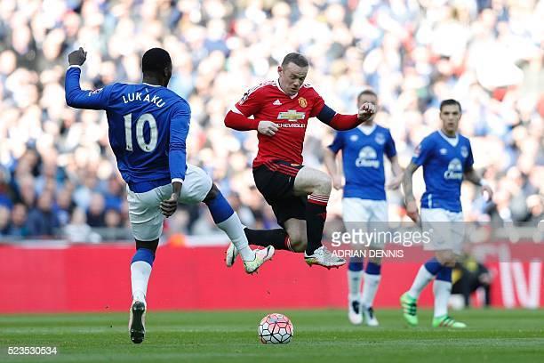 Everton's Belgian striker Romelu Lukaku tangles with Manchester United's English striker Wayne Rooney during the English FA Cup semifinal football...
