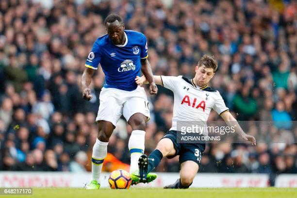 Everton's Belgian striker Romelu Lukaku vies with Tottenham Hotspur's Welsh defender Ben Davies during the English Premier League football match...