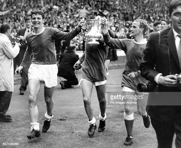 Everton's Brian Labone Mike Trebilcock and Alex Young parade the FA Cup around Wembley following their 32 win