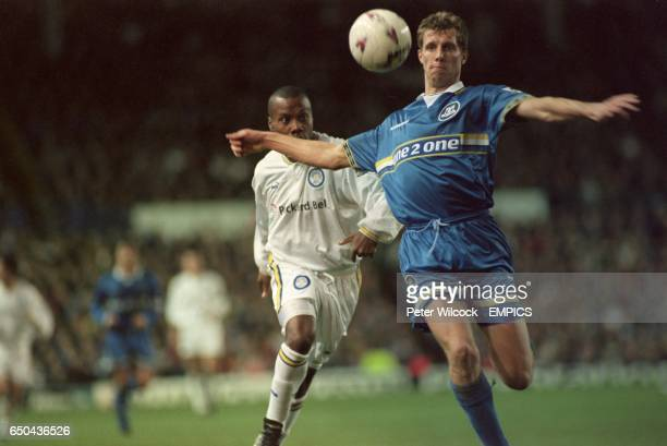Everton's Carl Tiler about to clear the ball over his head as Leeds United's Rod Wallace moves in to challenge