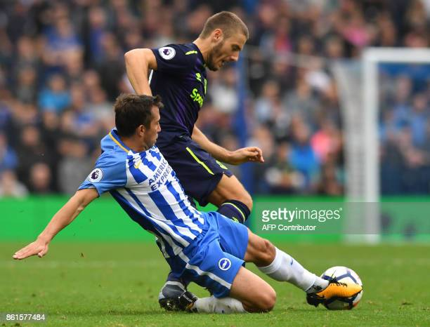 Everton's Croatian striker Nikola Vlasic vies with Brighton's Austrian defender Markus Suttner during the English Premier League football match...