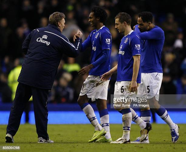 Everton's David Moyes congatulates his player Joao Alves Jo on his performance after the final whistle Also in the picture are Everton's Phil...