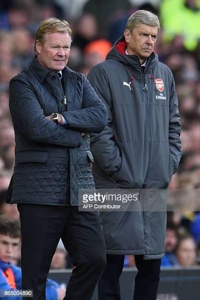 Everton's Dutch manager Ronald Koeman and Arsenal's French manager Arsene Wenger watch from the touchline during the English Premier League football...