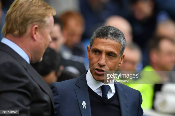 Everton's Dutch manager Ronald Koeman and Brighton's Irish manager Chris Hughton chat prior to the English Premier League football match between...