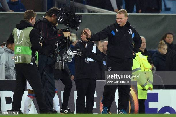Everton's Dutch manager Ronald Koeman gestures to the cameraman at the final whistle in the UEFA Europa League Group E match between Everton and Lyon...