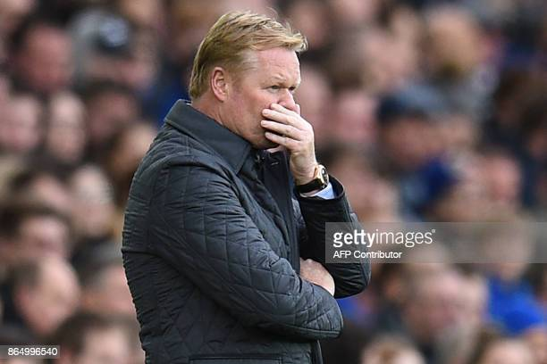 Everton's Dutch manager Ronald Koeman reacts on the touchline shortly after Arsenal scored their second goal during the English Premier League...