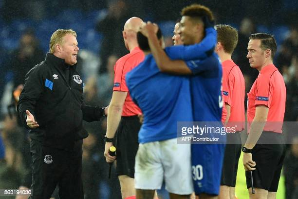 Everton's Dutch manager Ronald Koeman speaks to the officials on the pitch after the UEFA Europa League Group E match between Everton and Lyon at...