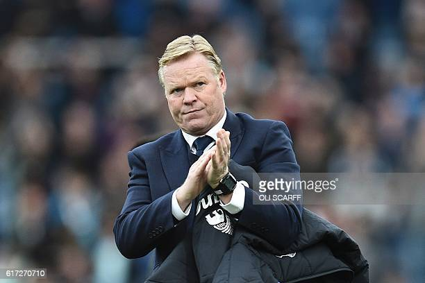 Everton's Dutch manager Ronald Koeman walks on the pitch at the end of the English Premier League football match between Burnley and Everton at Turf...