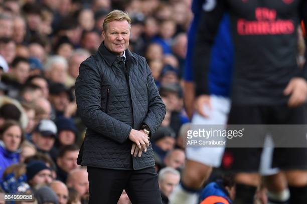 Everton's Dutch manager Ronald Koeman watches from the touchline during the English Premier League football match between Everton and Arsenal at...