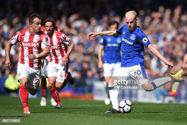 Everton's Dutch midfielder Davy Klaassen crosses the ball during the English Premier League football match between Everton and Stoke City at Goodison...
