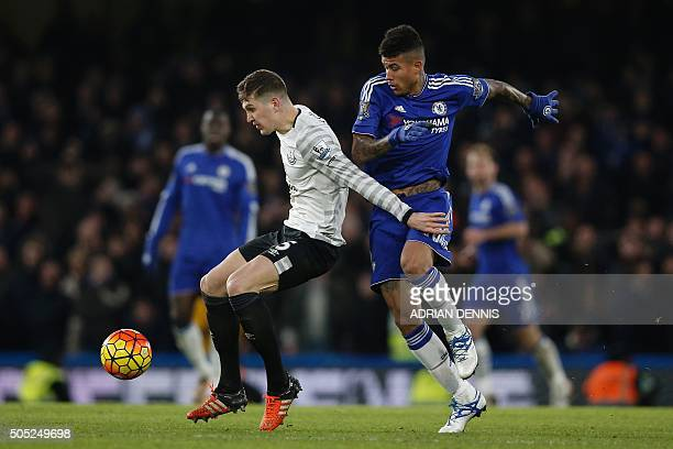 Everton's English defender John Stones tries to hold off Chelsea's Brazilian striker Kenedy during the English Premier League football match between...
