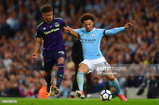 Everton's English defender Mason Holgate vies with Manchester City's German midfielder Leroy Sane during the English Premier League football match...