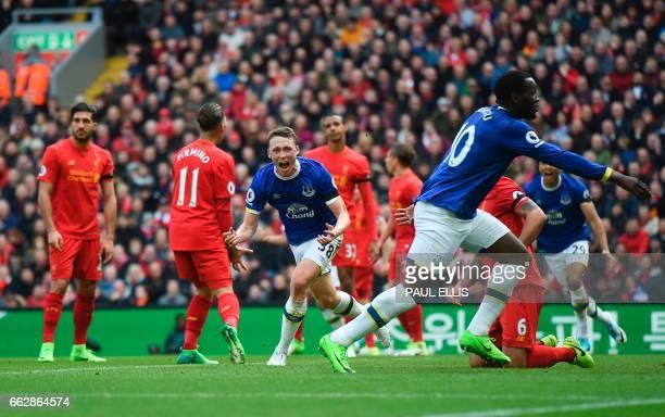 Everton's English defender Matthew Pennington celebrates after scoring their first goal during the English Premier League football match between...