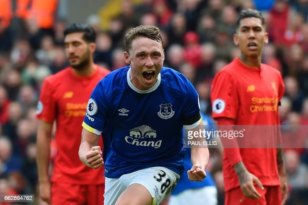 Everton's English defender Matthew Pennington celebrates after scoring their first goal during the English Premier League football match between...