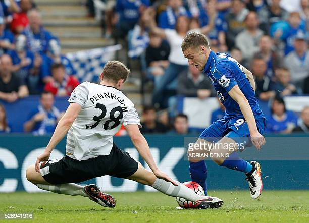 Everton's English defender Matthew Pennington tackles Leicester City's English striker Jamie Vardy during the English Premier League football match...