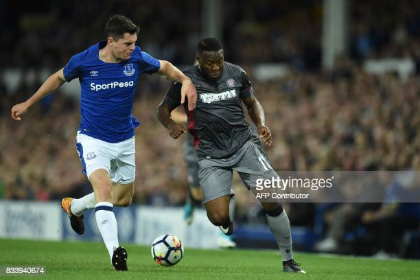 Everton's English defender Michael Keane vies with Hajduk Split's Cameroonian striker Franck Ohandza during the UEFA Europa League playoff round...