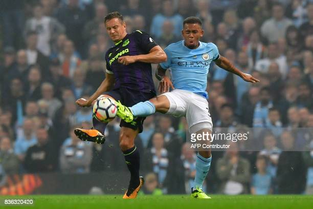 Everton's English defender Phil Jagielka vies with Manchester City's Brazilian striker Gabriel Jesus during the English Premier League football match...