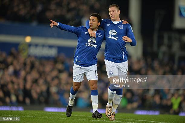 Everton's English midfielder Aaron Lennon celebrates with Everton's English midfielder Ross Barkley after scoring the opening goal of the English...