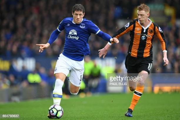 Everton's English midfielder Ross Barkley vies with Hull City's English midfielder Sam Clucas during the English Premier League football match...
