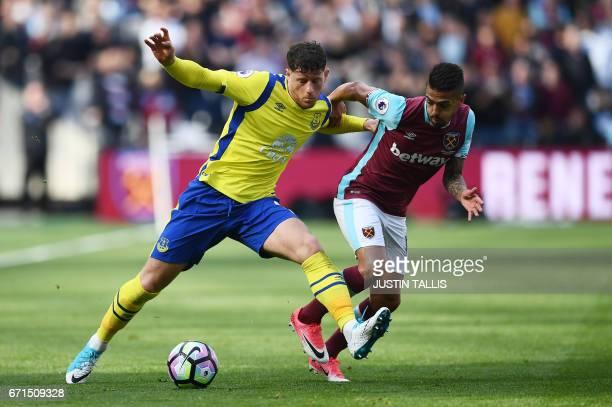 Everton's English midfielder Ross Barkley vies with West Ham United's Argentinian midfielder Manuel Lanzini during the English Premier League...