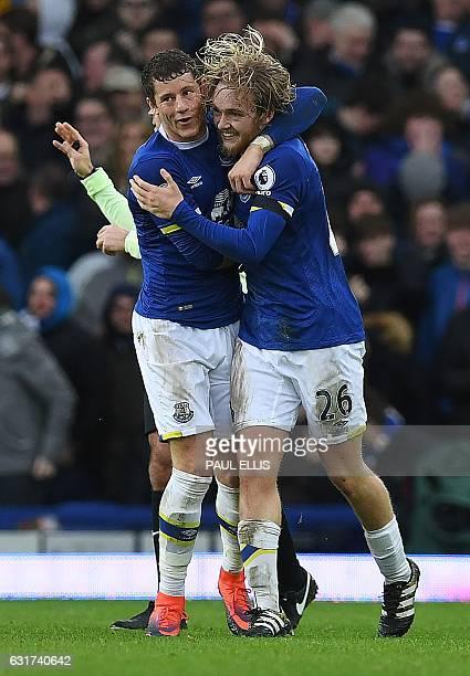 Everton's English midfielder Tom Davies celebrates with Everton's English midfielder Ross Barkley after scoring their third goal during the English...