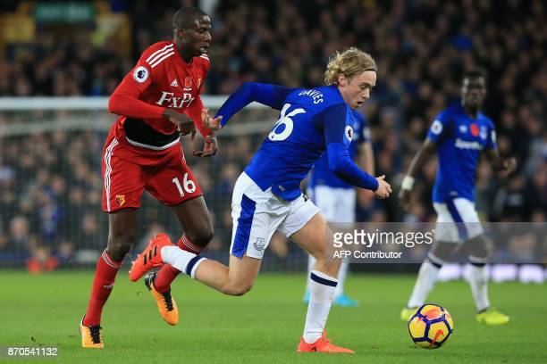 Everton's English midfielder Tom Davies outruns Watford's French midfielder Abdoulaye Doucoure during the English Premier League football match...