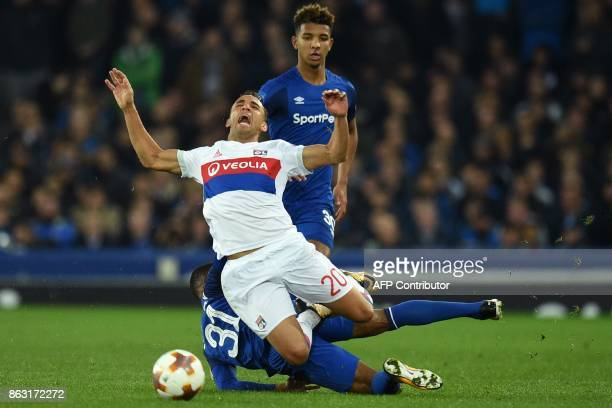 Everton's English striker Ademola Lookman receives a yellow card for this foul on Lyon's Brazilian defender Fernando Marcal during the UEFA Europa...
