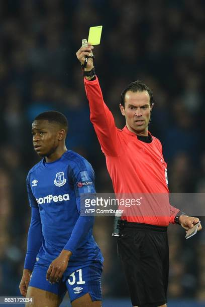Everton's English striker Ademola Lookman receives a yellow card from Dutch referee Bas Nijhuis during the UEFA Europa League Group E match between...