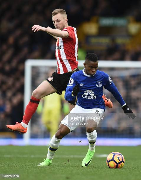 Everton's English striker Ademola Lookman takes on Sunderland's Swedish midfielder Sebastian Larsson during the English Premier League football match...